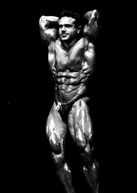 John Terilli abdominals pose on the bodybuilding stage